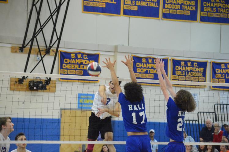 Ardi Kodzodziku smashes the ball over the net. (Bee Photo, Hutchison)