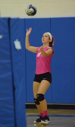 Jackie Moccio puts a serve into play. (Bee Photo, Hutchison)