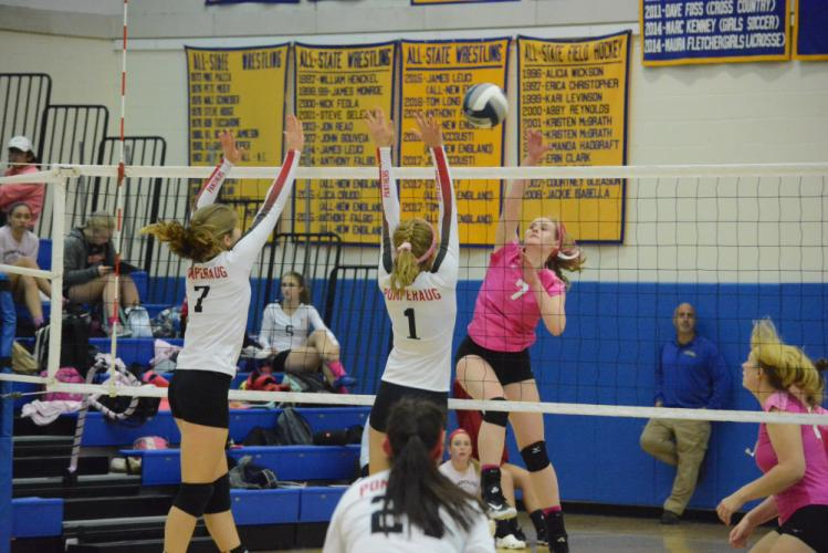 Sarah Dowling hits the ball over the net during Newtown's win over Pomperaug. (Bee Photo, Hutchison)