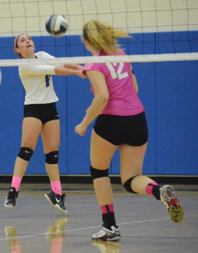 Tess Mubarek keeps the ball in play as Erin Mitchell gets into position. (Bee Photo, Hutchison)