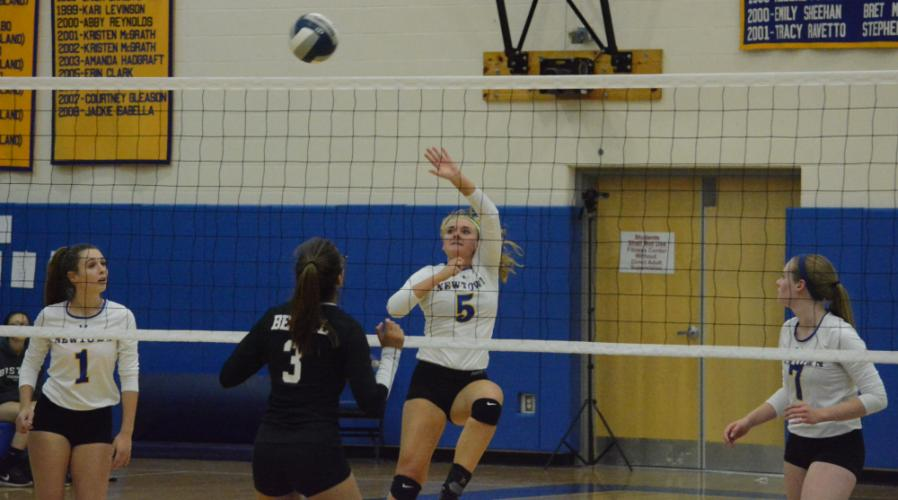 Julia Anderson follows through on her hit. (Bee Photo, Hutchison)