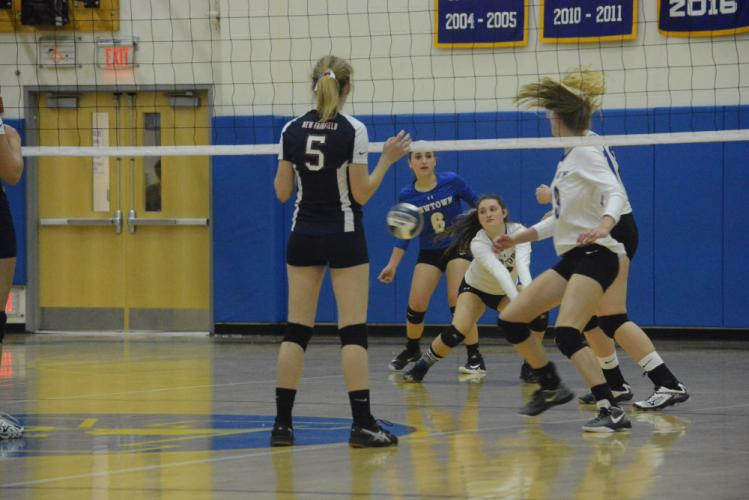 Mollie Goudy keeps the ball moving as teammates, including Tess Mubarek (No. 6) look on. (Bee Photo, Hutchison)