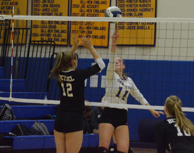 Rachel O'Grady hits the ball over the net during Newtown's win over Bethel. (Bee Photo, Hutchison)