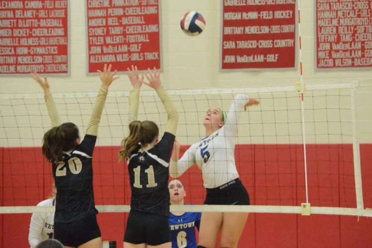 Julia Anderson hits the ball over the net. (Bee Photo, Hutchison)