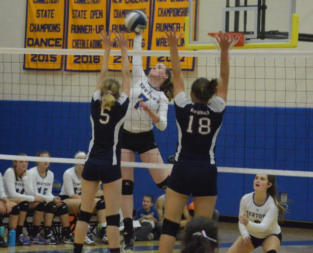 Sarah Dowling spikes the ball. (Bee Photo, Hutchison)