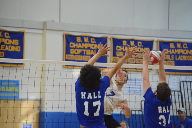 Robbie Morrill follows through on his hit at the net. (Bee Photo, Hutchison)