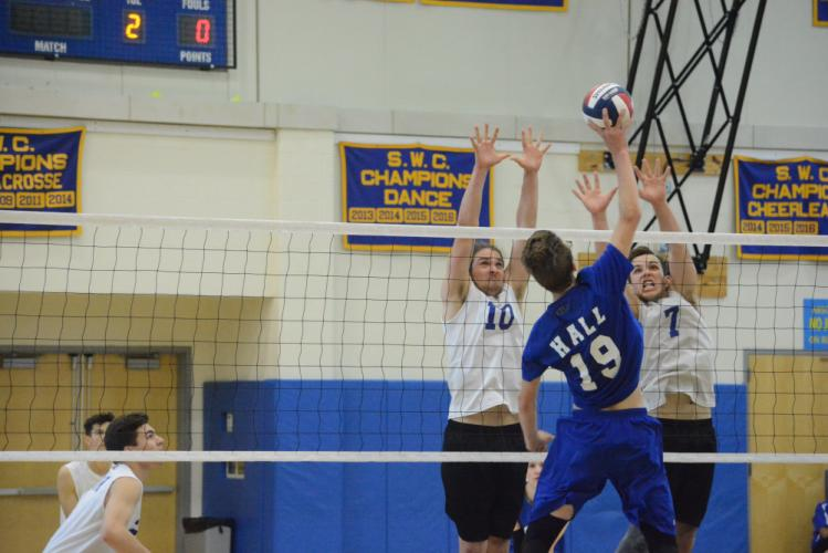 Silas Decker, left, and Robbie Morrill go up for a block. (Bee Photo, Hutchison)