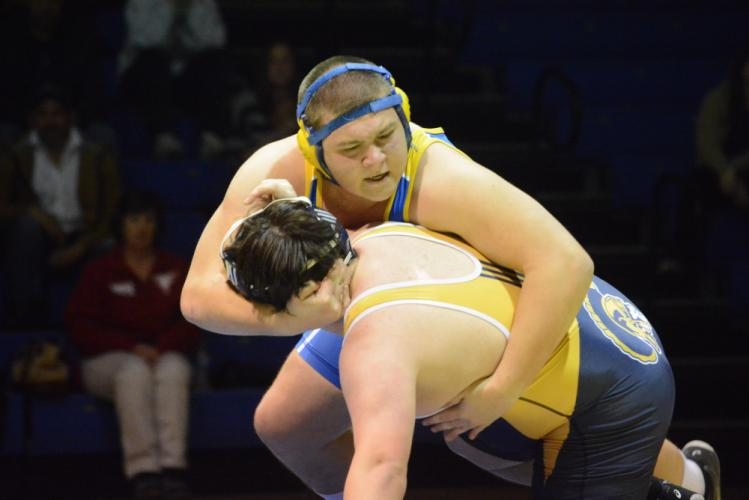 Joe Zeller, top, and a New Fairfield grappler tangle during Newtown's season-opening win. (Bee Photo, Hutchison)
