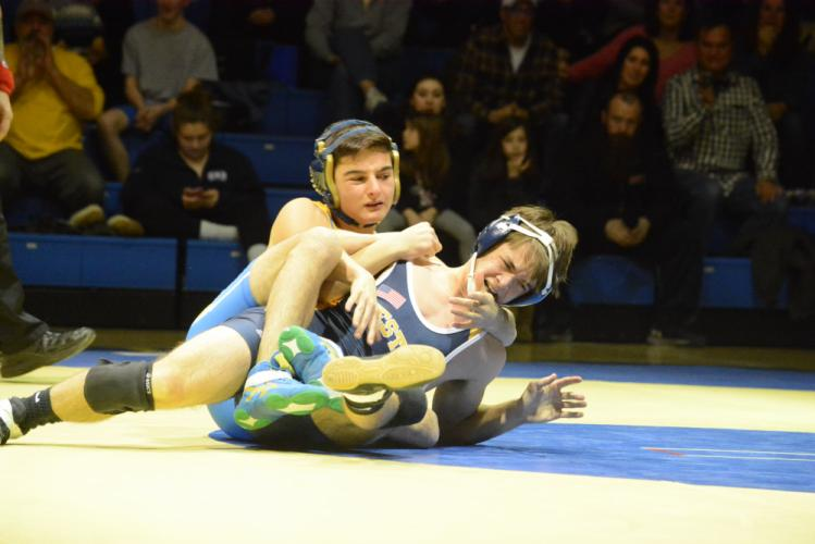 Justin Bogdanoff, left, competes during early-season action. (Bee Photo, Hutchison)