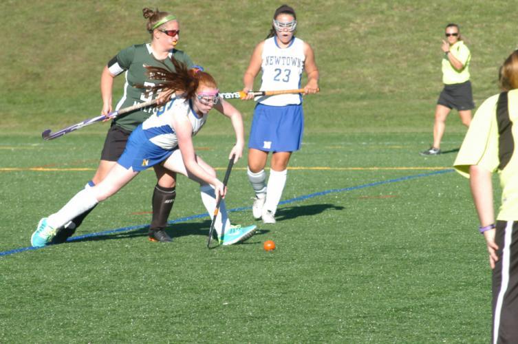 Megan Kelleher makes a pass as Emily Davis (No. 23) looks on.