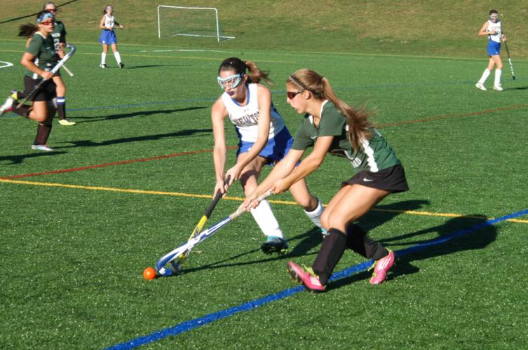 Caroline Tanner, left, and a New Milford player compete during Newtown's 2-1 loss to the Green Wave at Treadwell Park on September 24. Newtown had been unbeaten in five straight games to begin the campaign.