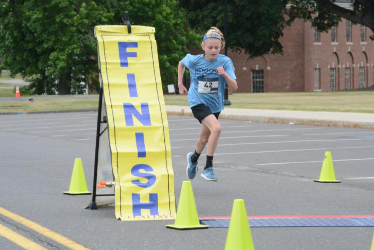 Riley Powers was the top female in the 5K. (Bee Photo, Hutchison)