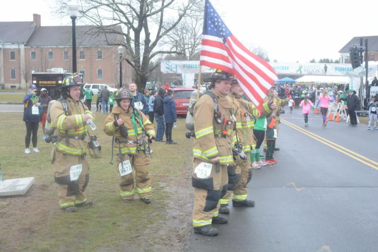 Sandy Hook firefighters cheer for the runners after completing the 5K themselves. (Bee Photo, Hutchison)