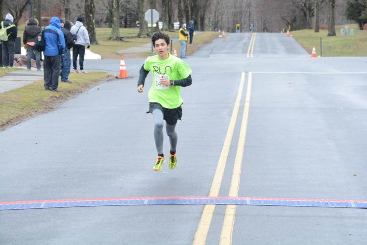 Parker McKenzie was fourth and was the second-fastest Newtown/Sandy Hook finisher. (Bee Photo, Hutchison)