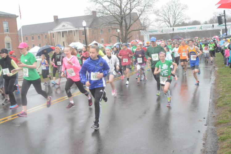 Runners take off at the start of the Sandy Hook 5K, at Fairfield Hills, on April 1. (Bee Photo, Hutchison)