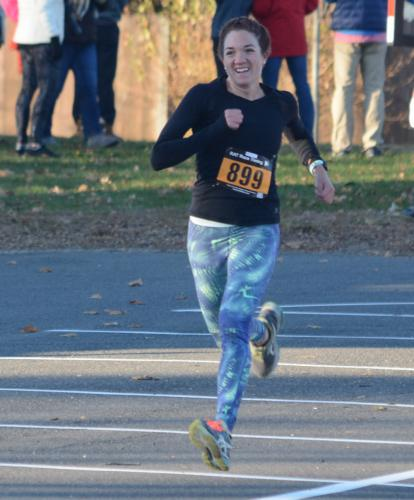 Brittaney Wyszynski, of Los Angeles and whose parents live in Newtown, was the top female finisher. She clocked in at 19:35. (Bee Photo, Hutchison)