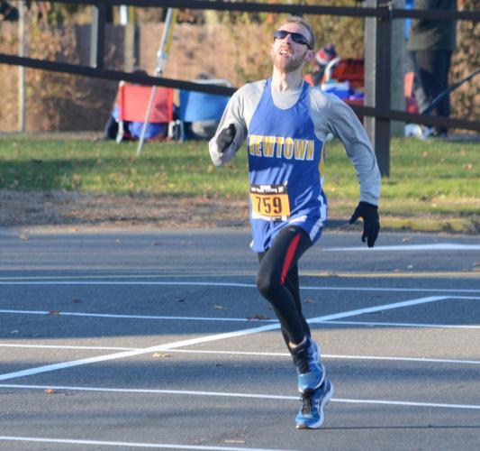 Zach Schwartz won his third straight Turkey Trot, finishing in 16:29. (Bee Photo, Hutchison)