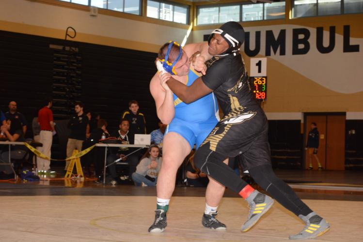 Joe Zeller, left, battled to a second-place finish in the 285 pound weight division. (Bee Photo, Hutchison)