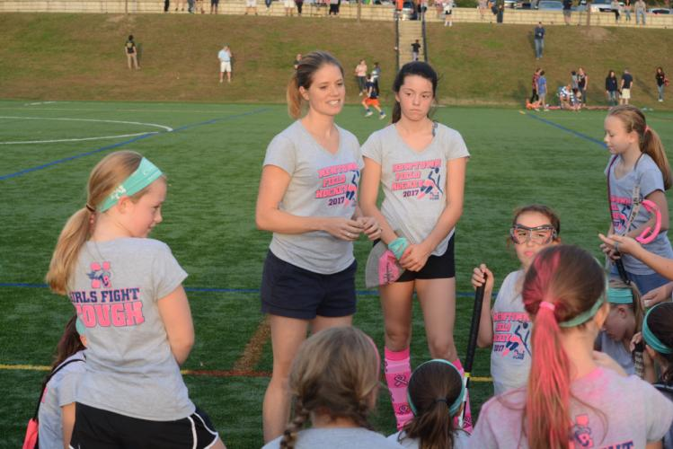 Coach Amy Krompinger meets with her players after a game this fall. Standing next to the coach, to the right, is Morgan Melillo is next to me. Among the players are Paige Jackson, far left, and Nella Walsh, far right. (Bee Photo, Hutchison)