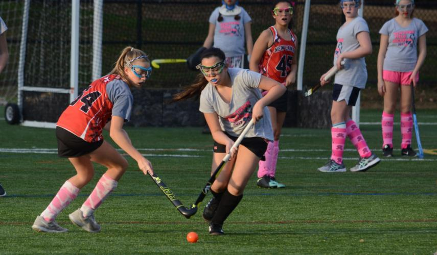 Erin Shah runs with the ball during a game against New Canaan. (Bee Photo, Hutchison)