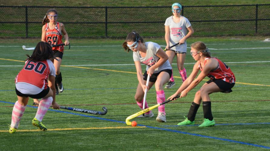 Morgan Melillo and New Canaan players go for the ball. (Bee Photo, Hutchison)