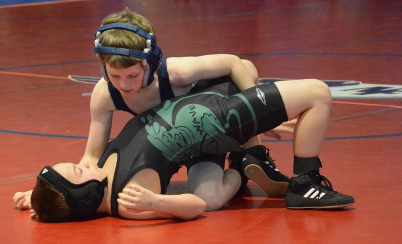 Jake Maddox competes on the mat. (Bee Photo, Hutchison)