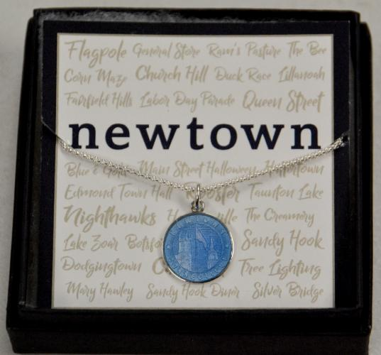 Pictured is a popular 5 Janes pendent representing Newtown with its replica of Trinity Episcopal Church and Meeting House steeples and the Main Street flagpole. (Bee Photo, Silber)