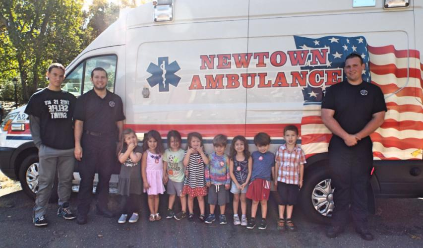 Pictured from left are Misty Morning volunteer from Newtown Community Partnership Aaron Terhune, Newtown Volunteer Ambulance Corps member Dan Cragin, and, far right, Newtown Volunteer Ambulance Corps member Sean Donnelly on Tuesday, October 12 at…