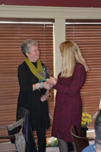 """Anne Stark, pictured left, presented Ms Widmann with an award on behalf of the Newtown Board of Realtors for her """"outstanding and valuable service"""" as president during the Board of Realtors Luncheon on November 16. (Bee Photo, Silber)"""