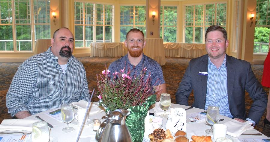 From left are members from Newtown Young Professionals Chris Ciskey, Kris Kling, and Sean Reilly at the Newtown Giving Circle's 29th Annual Summer Breakfast at The Waterview. Newtown Young Professionals provides career-minded individuals…