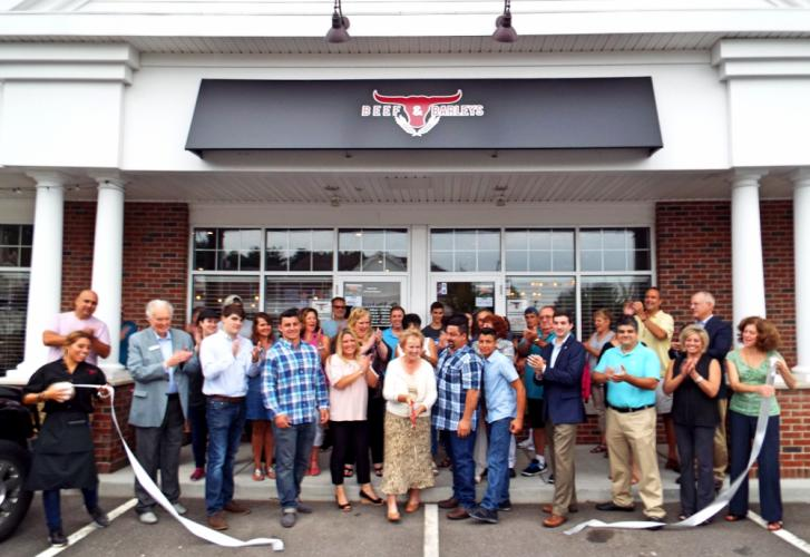 Beef & Barleys at 274 South Main Street celebrated its grand opening with a ribbon cutting ceremony Thursday, July 27. In attendance were many friends, family, and local supporters, including First Selectman Pat Llodra, pictured holding the big…