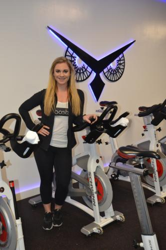 Newtown resident Emily DeMarco purchased BoostCycle in Plaza South on March 9. The indoor cycling studio offers riders a fun, full-body workout suitable for all experience levels. (Bee Photo, Silber)