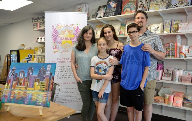 Pictured are Yvonne, Samantha, Natalie, Robert, and Matt Schapiro at Charmios' new shop in The Village at Lexington Gardens. Charmios is a canvas and pottery paint studio and boutique party store that opened in June. (Bee Photo, Silber)