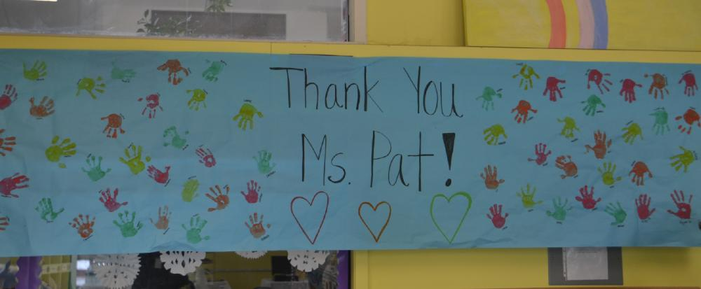 "A personalized banner that read ""Thank you Ms. Pat"" hung at the high tea event for Pat Llodra at the Children's Adventure Center and featured each student's handprints.  (Bee Photo, Silber)"