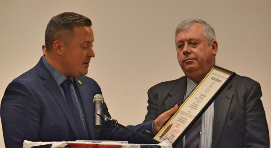 State Representative JP Sredzinski reads the proclamation to former Selectmen Will Rodgers, honoring him for his service to the Newtown community. (Bee Photo, Silber)