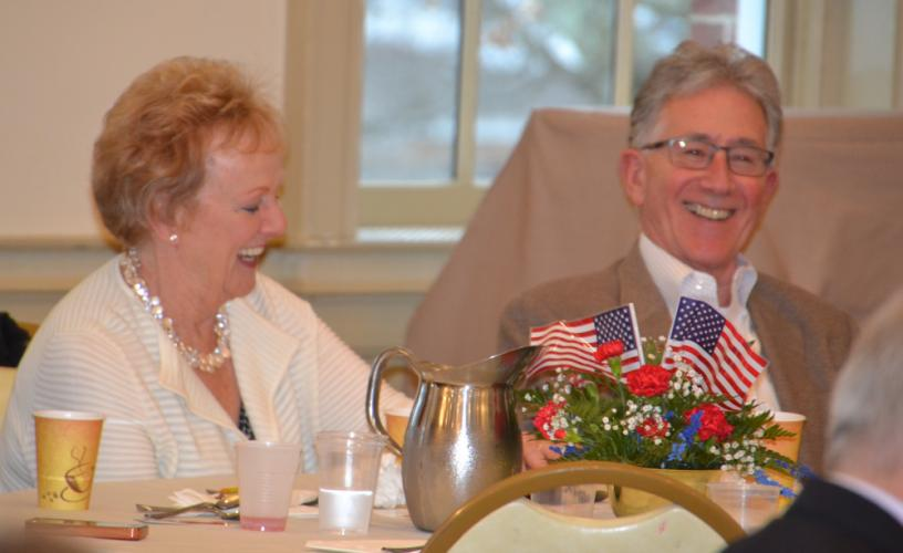 At the special ceremony, Patricia Llodra and her husband Bob laugh during friend and former Monroe First Selectman Steve Vavrek's speech to the crowd, about being Mrs Llodra's best golfing partner. (Bee Photo, Silber)