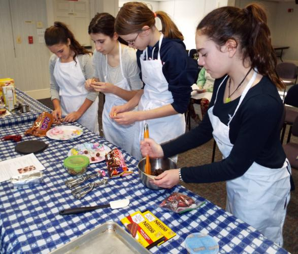 C.H. Booth Library teen chefs, pictured from left, Lilly Chenoweth, Caroline Cassetta, Margaret Hurley, and Molly Connors, made delicious treats during the Chocolate Test Kitchen in February. (Bee Photo, Silber)