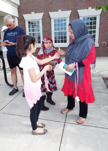 Mariam Bhavnagarwala gave out stickers to young Khadijah Noori and her mother Masuma Noori at the CROP Hunger Walk on Sunday, October 15. (Bee Photo, Silber)