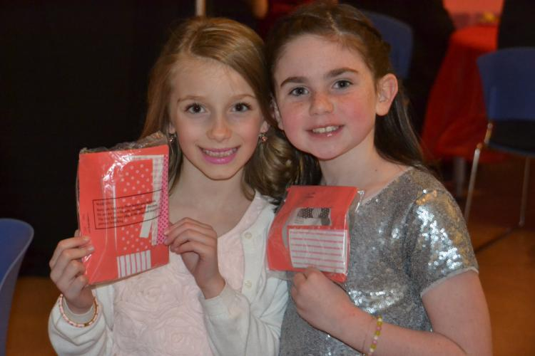 Pictured from left at the Daddy & Daughter Valentine Ball are friends Amelia Nash, 8, and Pearson Previdi, 7, eager to begin their arts and crafts project making Valentine's Day-themed picture frames. (Bee Photo, Silber)