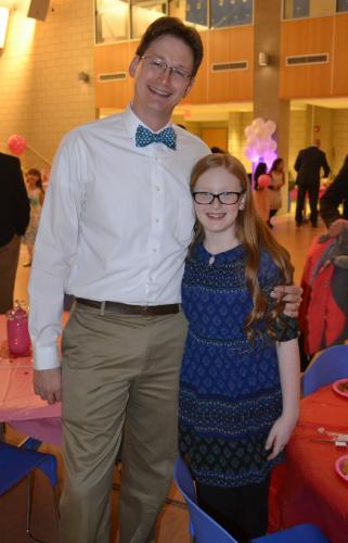 Eric Ekman and his daughter, Adlien, 10, were excited to be attending their second dance together at the Daddy & Daughter Valentine Ball, February 2. (Bee Photo, Silber)