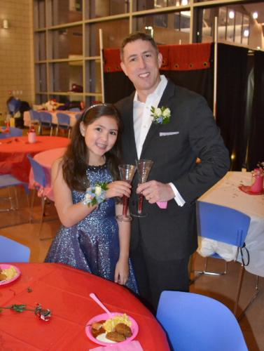 Ten-year-old Sara Heinen and her father Eric clink glasses together in celebration of the Second Annual Daddy & Daughter Valentine Ball. (Bee Photo, Silber)