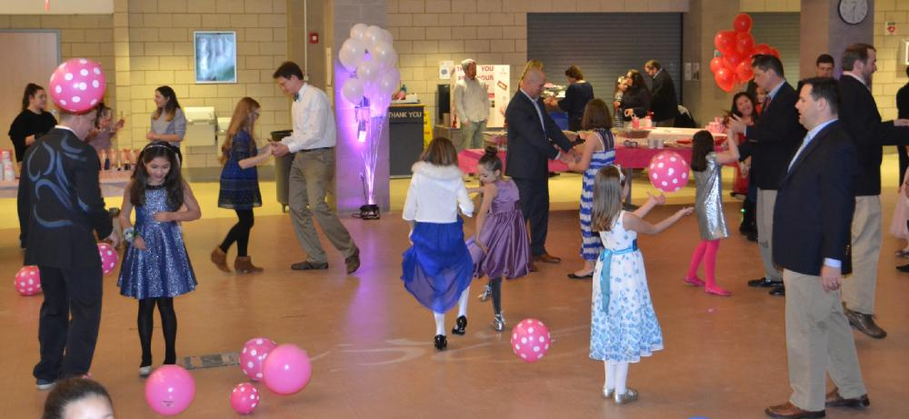 At the Second Annual Daddy & Daughter Valentine Ball, attendees enjoy a night full of dancing with their special valentines in the Newtown High School cafetorium on February 2. (Bee Photo, Silber)