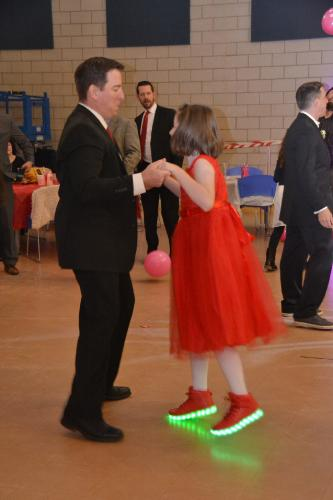 At the Second Annual Daddy & Daughter Valentine Ball, on February 2, Aaron Arbesman and his daughter Julia, 10, lit up the dance floor with her colorful shoes. (Bee Photo, Silber)