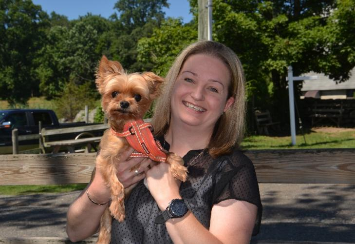 Newtown resident Laura Becker holds her beloved 9-year-old Yorkie, Oliver, post-surgery, during a visit to Ferris Acres Creamery on July 19. (Bee Photo, Silber)