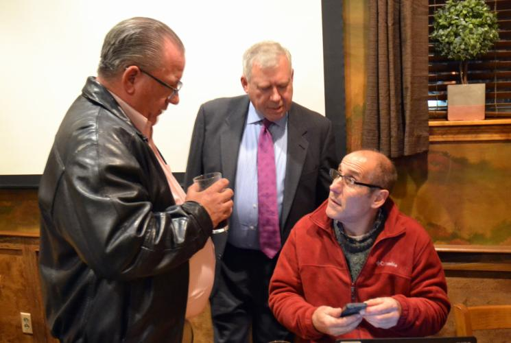 Republican First Selectman hopeful Will Rodgers, center, intently studies incoming poll numbers with running mate Jeff Capeci, seated, while Legislative Councilman Dan Wiedemann looks on.   (Bee Photo, Silber)