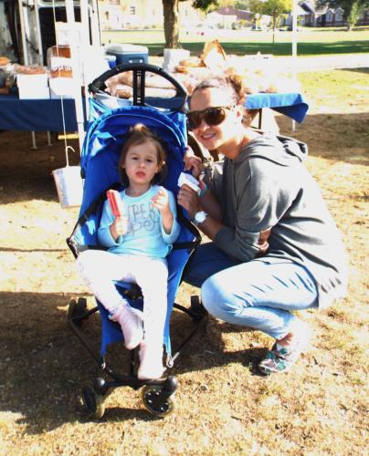 On October 3, Barbie Urbankski visited the Newtown Farmer's Market at Fairfield Hills with young Adamina Urbankski. (Bee Photo, Silber)