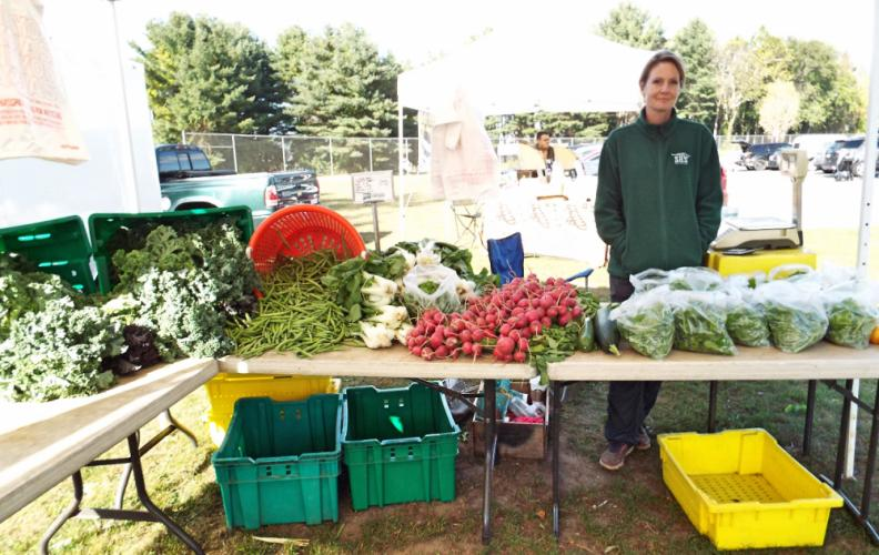 Market Master Sue Shortt of Shortts Farm in Sandy Hook had a wide variety of locally grown goods at the Newtown Farmer's Market on October 3. (Bee Photo, Silber)