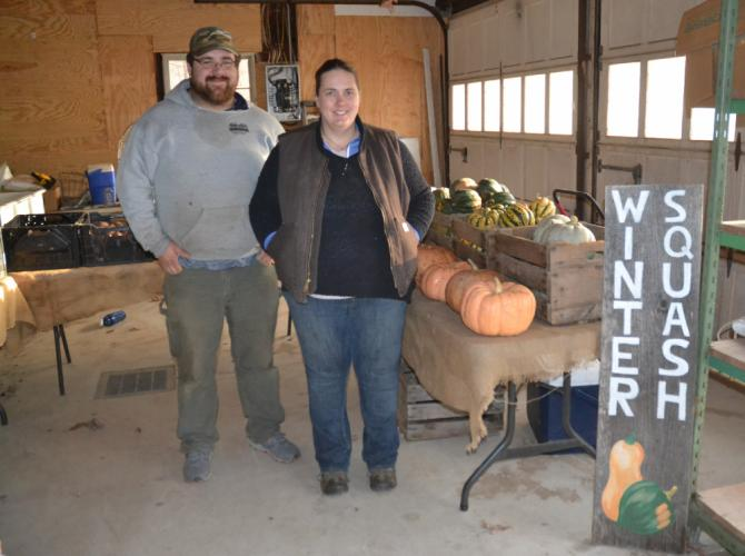 Daffodil Hill Growers at Woodside Farm owners Dan Slywka and Sara Blersch stand before their pop-up market, located at 124 Horse Fence Hill Road in Southbury, where CSA members can pick up their products every Tuesday. (Bee Photo, Silber)