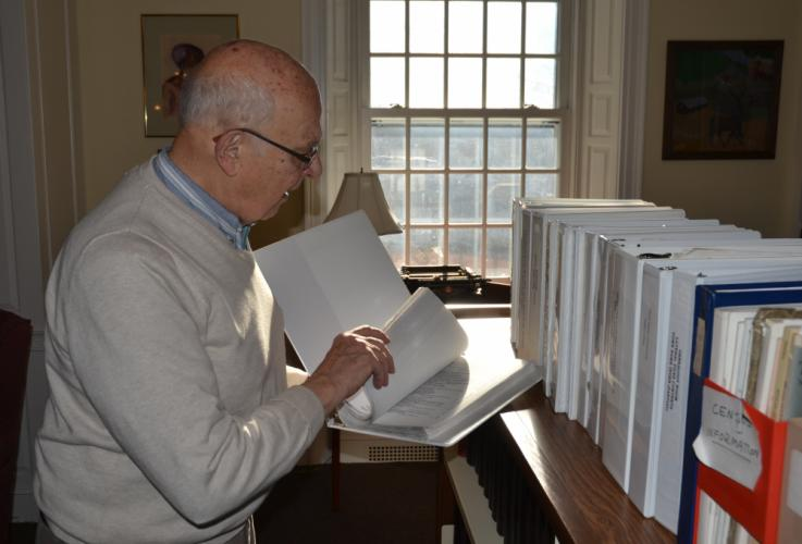 While discussing the many resources the C.H. Booth Library's new Genealogy Room has, longtime genealogy volunteer Harlan Jessup flipped through one of the many binders available for people to access. (Bee Photo, Silber)