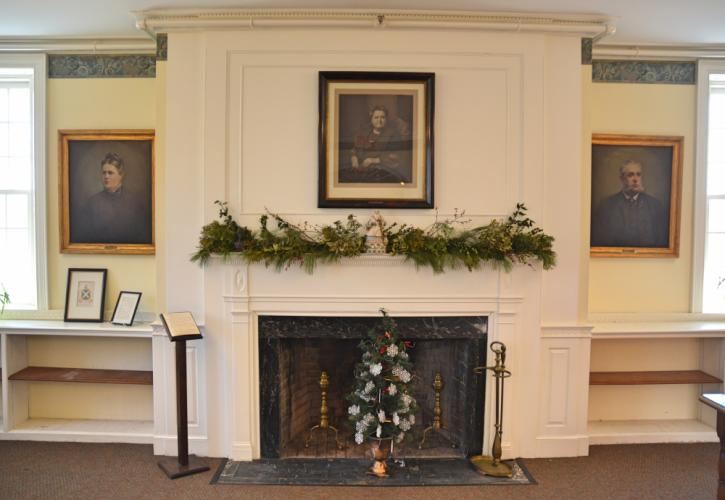 The C.H. Booth Library's former Genealogy Room is being transformed into a community area. The portrait of library benefactress Mary Hawley hangs above the room's festively decorated fireplace and mantel. (Bee Photo, Silber)